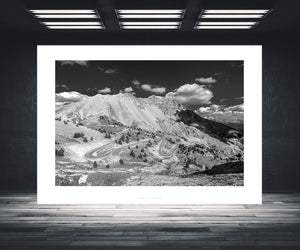 Col d'Izoard - Rider on the Road - Black and White fine art cycling landscape photography. One of the Great Cycling Road Climbs by davidt. For your home, office and pain cave.