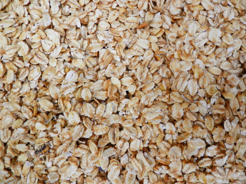 Rolled naked oats for birds