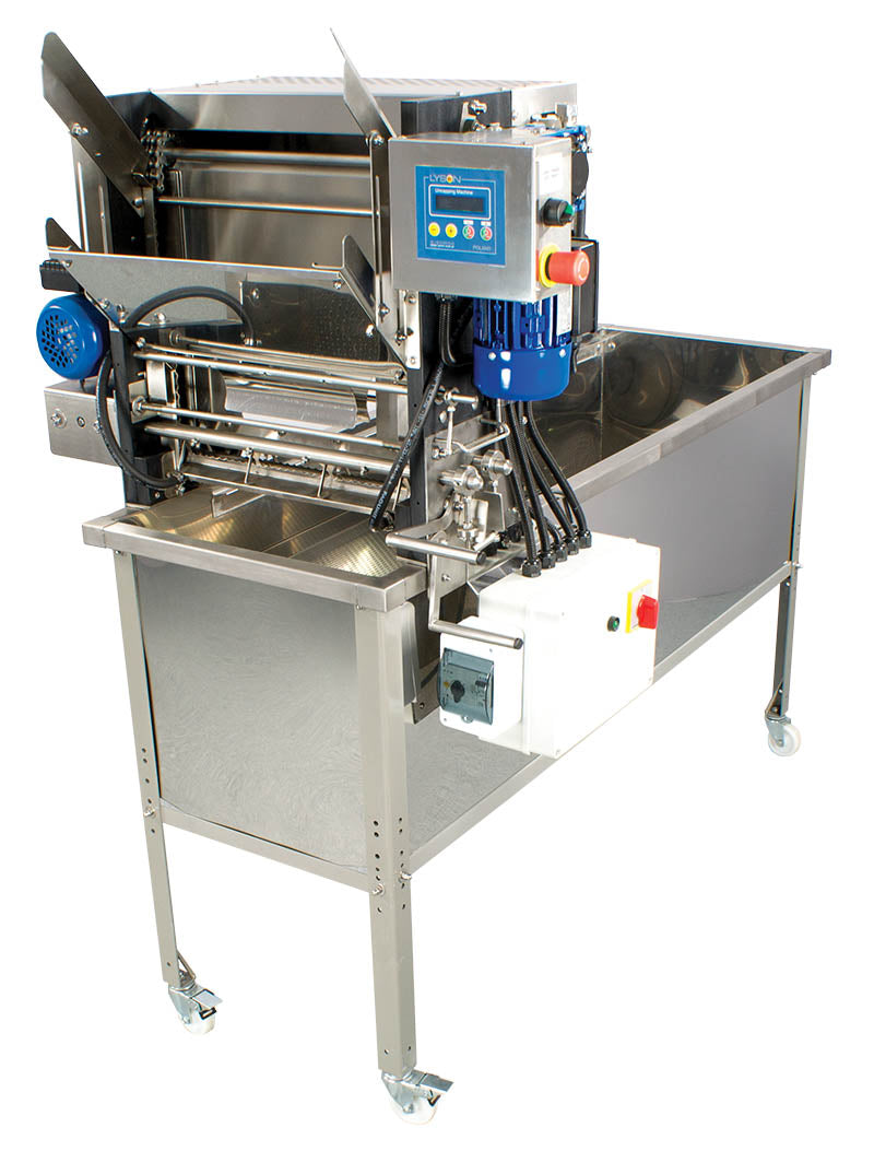 Automatic Uncapping Tank with Fluid Heated Blades