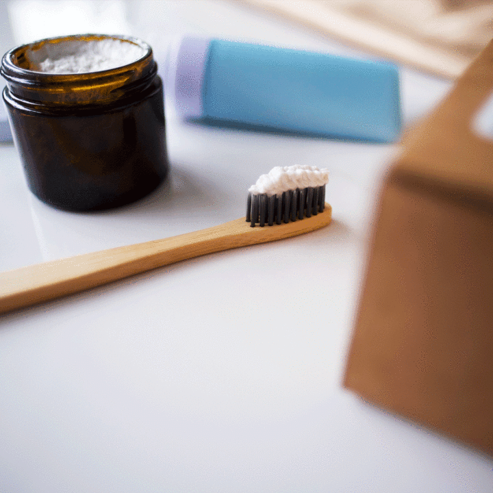 All-natural toothpaste on bamboo toothbrush