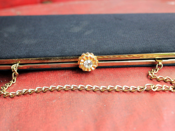 Vtg. Black with Gold Flower Rhinestone Clasp Clutch