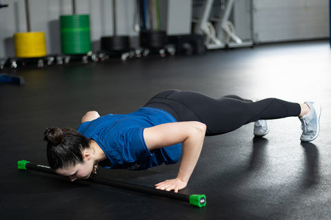 push up with weighted bar