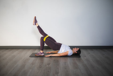 hip bridge with leg extensions with mini band 2