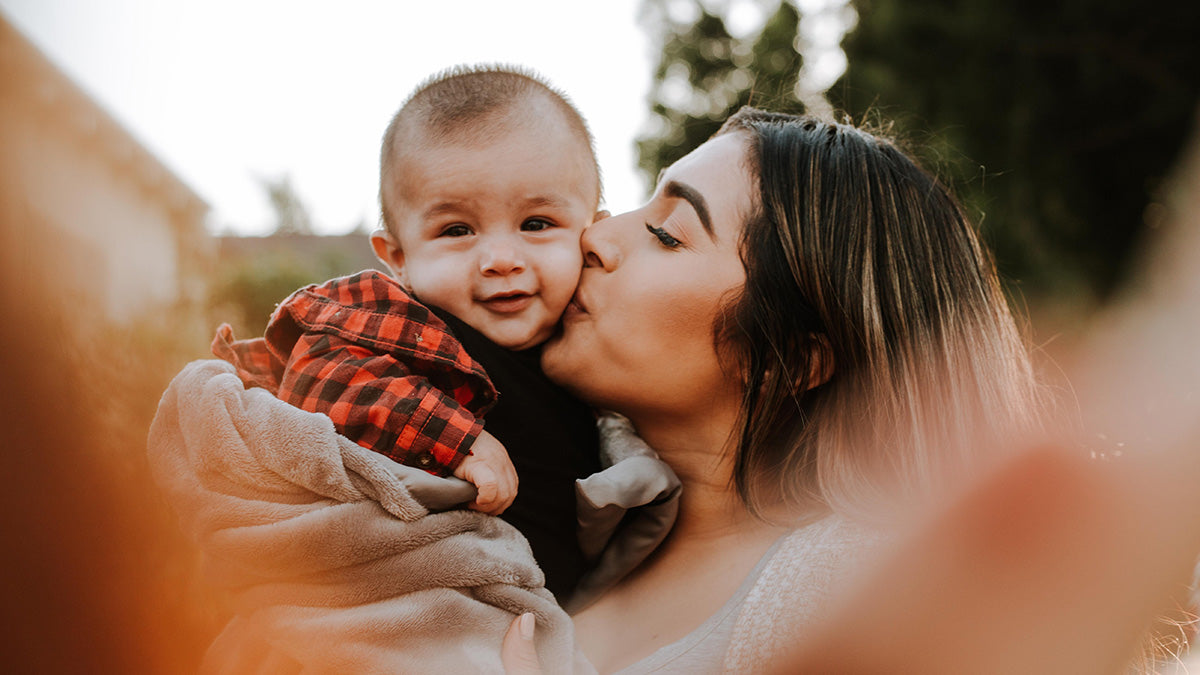 Bebitza Blog Post Image: It's an honour to be a mum. - Mother kissing baby boy.
