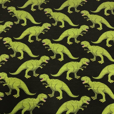 Dinosaurs on black cotton sweatshirting (by the half metre)
