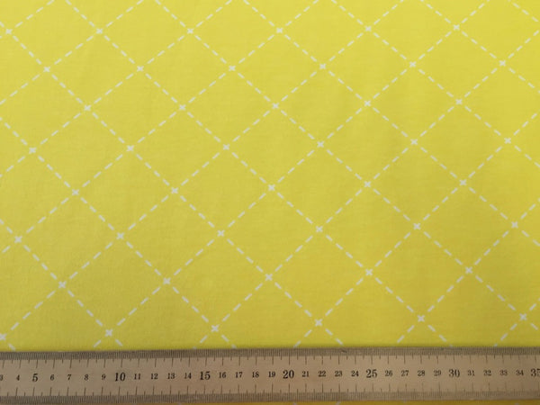 SALE Stitches yellow organic cotton sweatshirting (by the half metre)