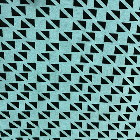 Turquoise small triangles cotton jersey (by the half metre)