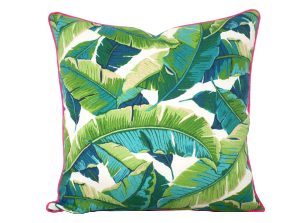 swaying palm print pillow with pink piping