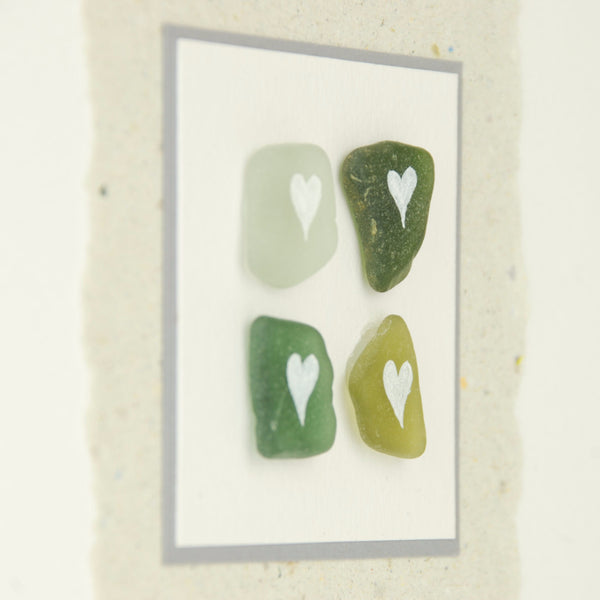 Hand-made greeting card with Scottish beach sea glass painted with simple white hearts