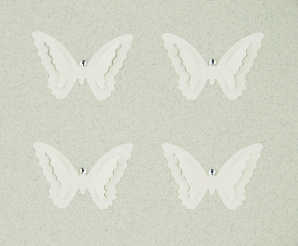 hand-made greeting card with off-white paper butterflies on pale grey card with diamante decoration