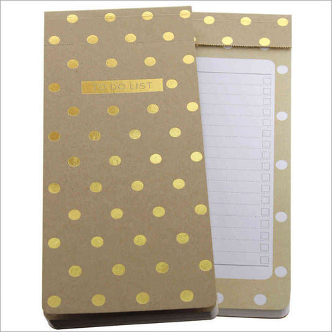 to-do list is finished with mini gold polka dots on a kraft cover