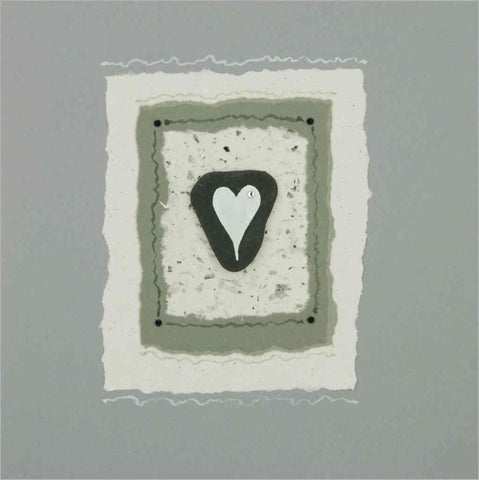 Greeting card with sea-washed slate with white painted heart on handmade paper and black diamantes