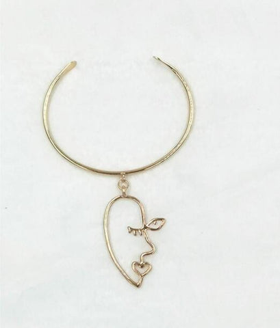 Abstract Face Dangle Cuff Bracelet
