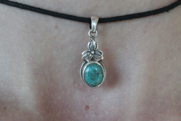Sterling silver turquoise gemstone pendant with black string