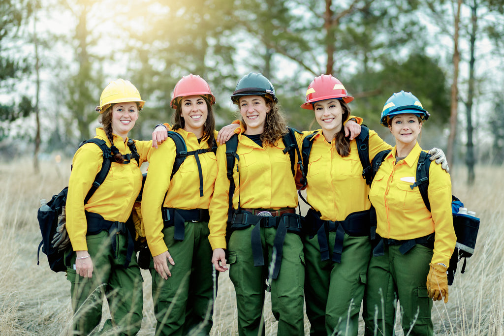 all woman wildland fire crew with gear ready to work