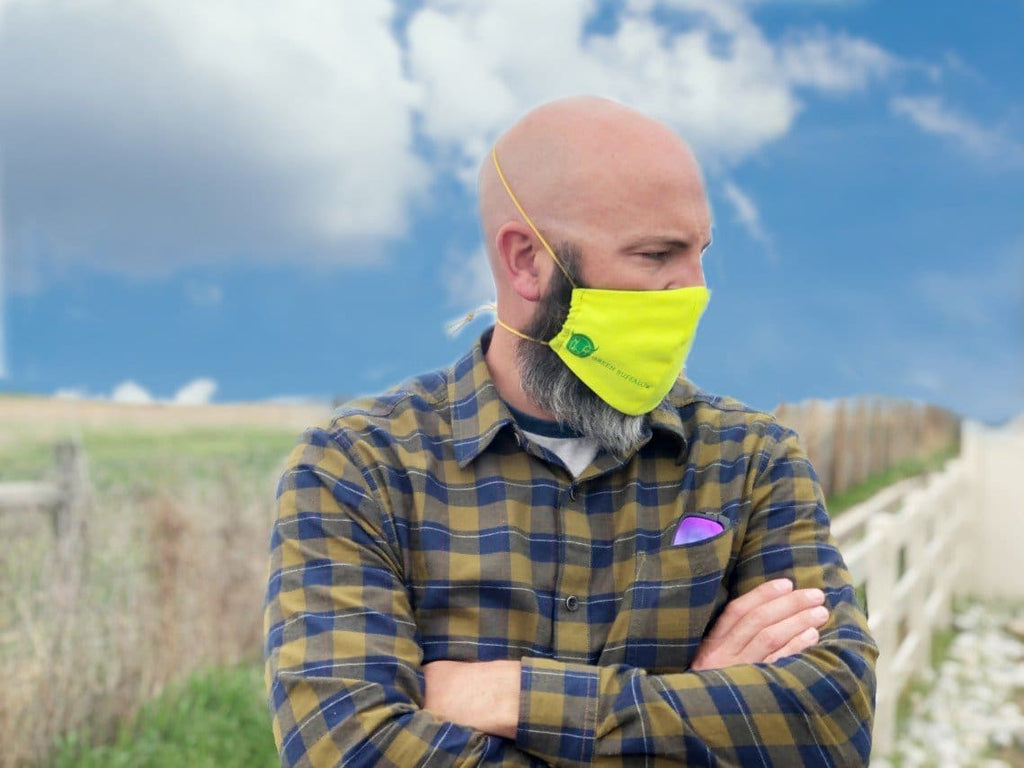 Man wearing FR Mask in field prepping for work