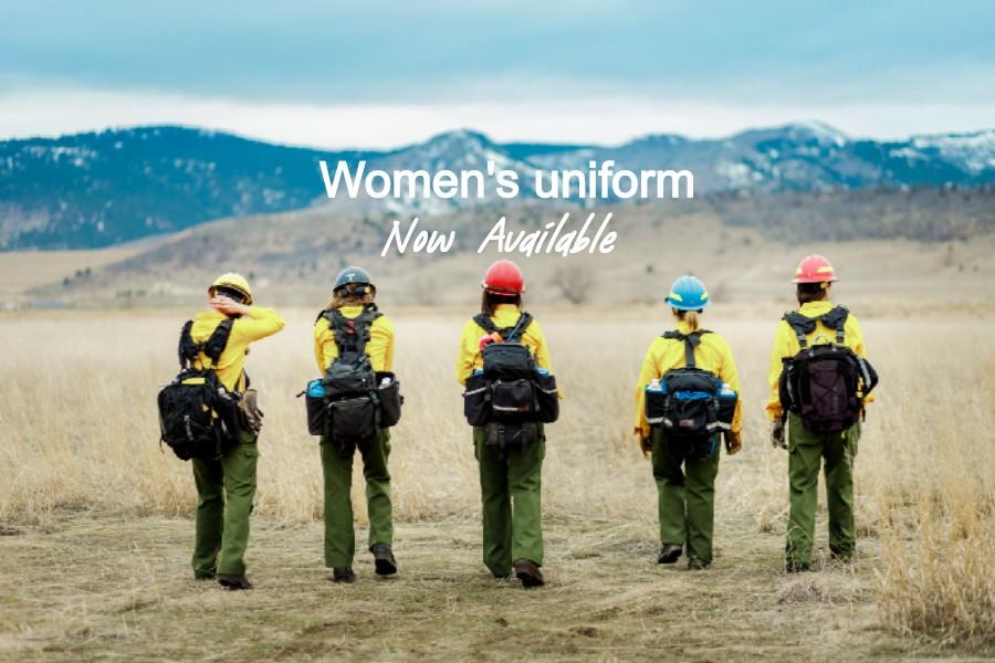 women in wildland fire gear hiking to forest fire