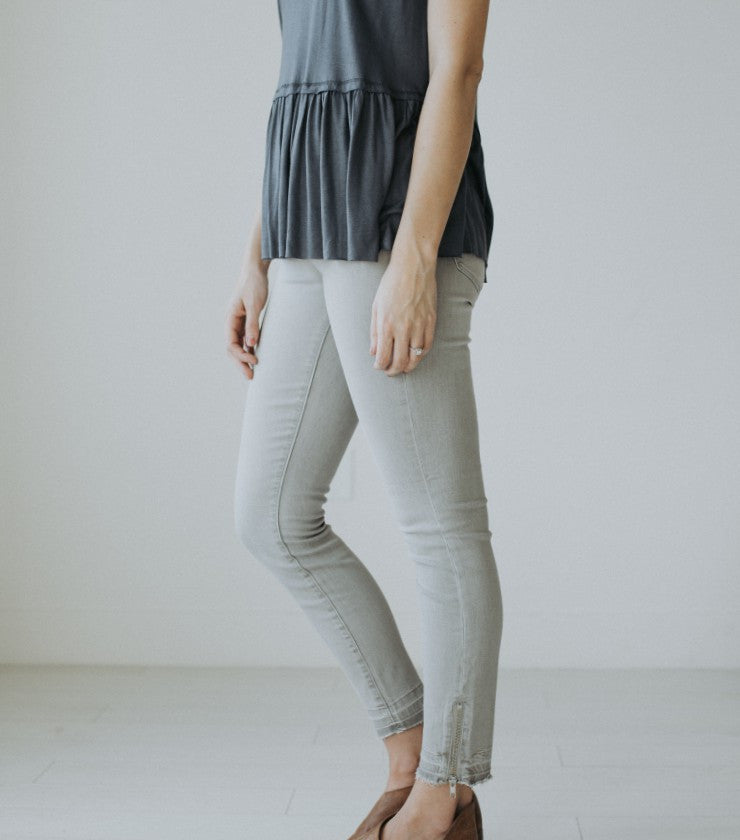 The Distressed Gray Zip Jean