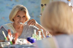 elderly woman, brushing teeth, oral health, oral care, good health