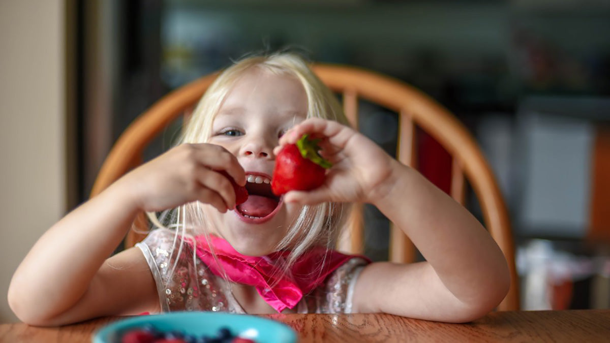 Healthy, young girl, eating fruit