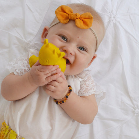 Baby with teething toy yellow natural rubber