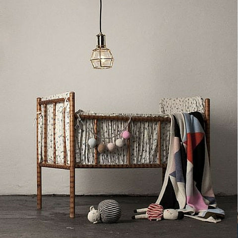 wicker cot with pleated lining