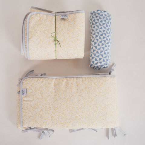 Ochre Cot Bed Gift Set with hand blocked muslin sheet, bumpers and quilt