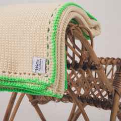 hand crocheted pram blanket trimmed in neon green wool