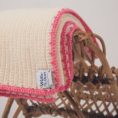 hand crocheted pram blanket trim in neon pink wool