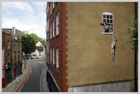 Banksy Man Hanging From Window - Park Street Bristol