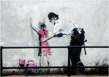 Banksy Policeman Searchin Girl Graffiti - Glastonbury, Somerset