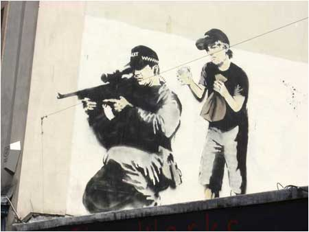 https://cdn.shopify.com/s/files/1/1003/7610/files/banksy-graffiti-sniper-and-boy.jpg?9671783544677538341