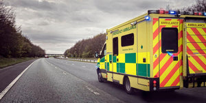 Ambulance responding to an emergency Wall Mural Wallpaper - Canvas Art Rocks - 1