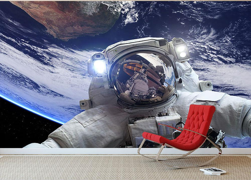 Astronaut in outer space against the backdrop Wall Mural Wallpaper - Canvas Art Rocks - 1