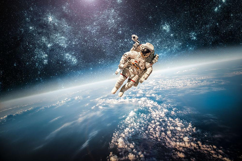 Astronaut in outer space planet earth Wall Mural Wallpaper - Canvas Art Rocks - 1