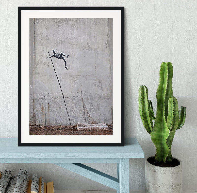 Banksy Pole Vaulter Framed Print - Canvas Art Rocks - 1