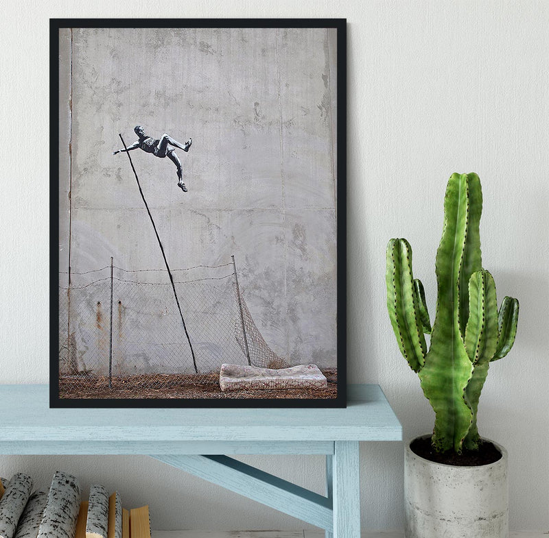 Banksy Pole Vaulter Framed Print - Canvas Art Rocks - 2
