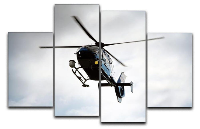Blue and silver police helicopter flying above 4 Split Panel Canvas