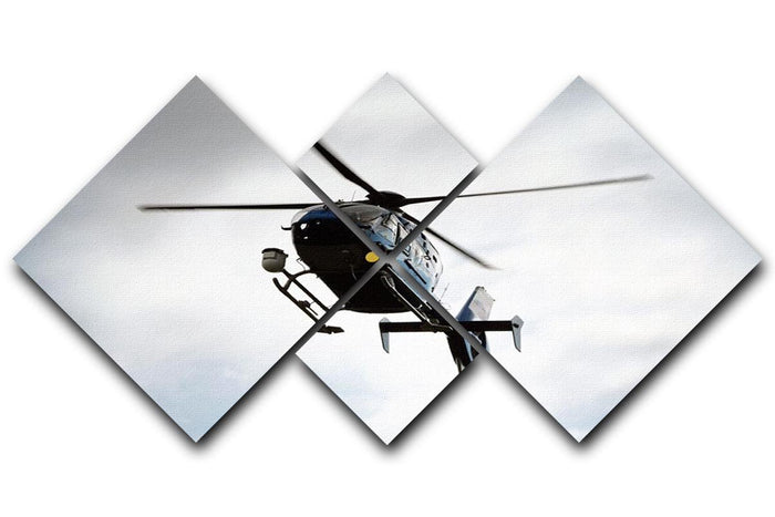 Blue and silver police helicopter flying above 4 Square Multi Panel Canvas