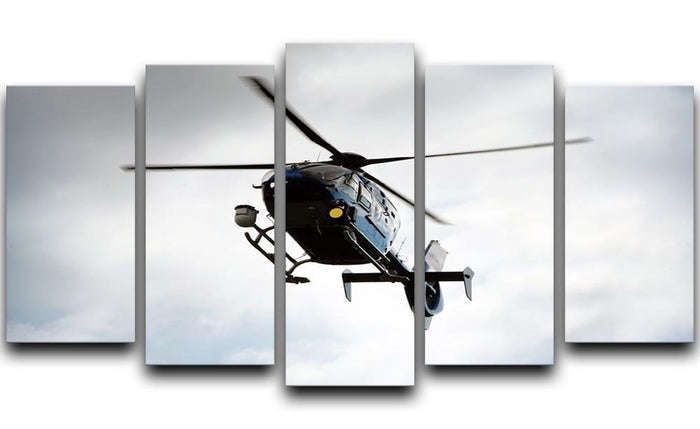Blue and silver police helicopter flying above 5 Split Panel Canvas