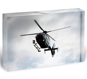 Blue and silver police helicopter flying above Acrylic Block - Canvas Art Rocks - 1