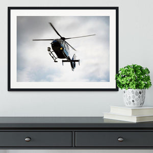 Blue and silver police helicopter flying above Framed Print - Canvas Art Rocks - 1