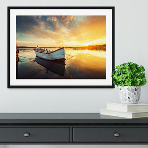 Boat on lake with a reflection Framed Print - Canvas Art Rocks - 1