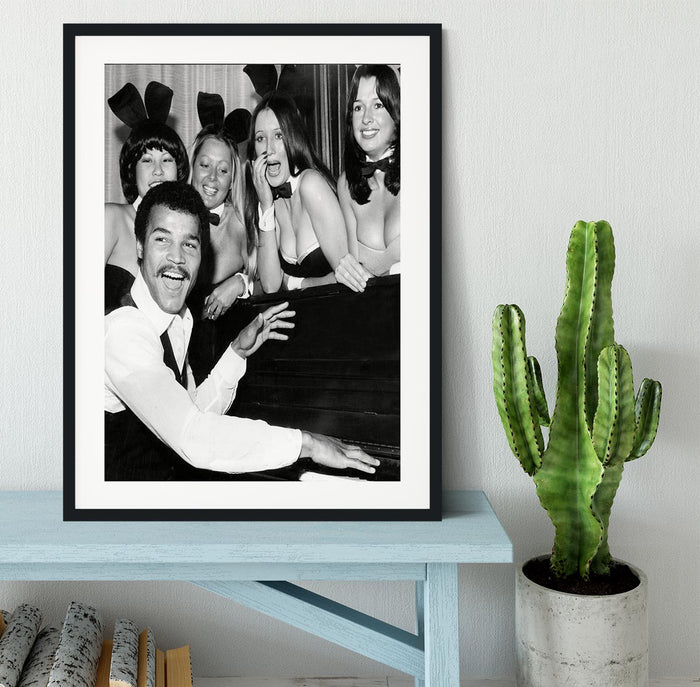 Boxer John Conteh with bunny girls at the playboy club Framed Print
