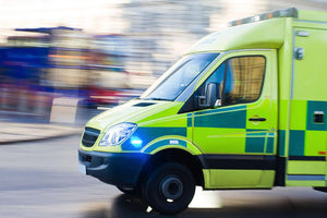 British ambulance in motion blur Wall Mural Wallpaper - Canvas Art Rocks - 1