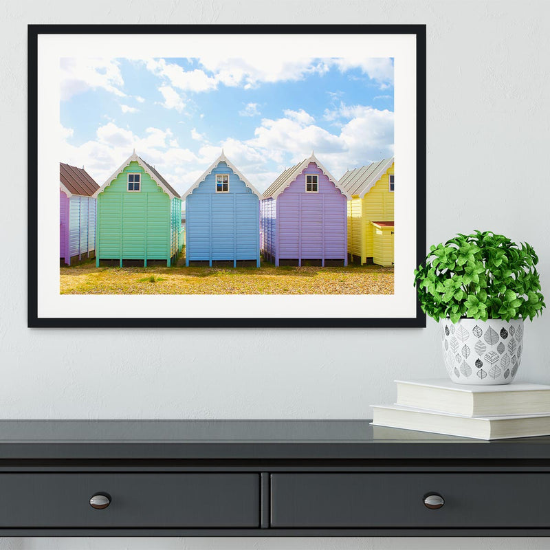 British beach huts on a bright sunny day Framed Print - Canvas Art Rocks - 1