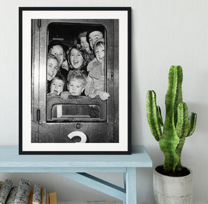 Cheerful train evacuees Framed Print - Canvas Art Rocks - 1