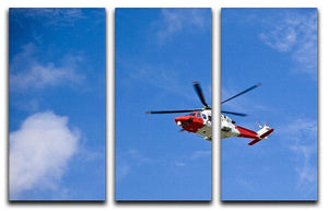 Coastguard helicopter in the blue sky 3 Split Panel Canvas Print - Canvas Art Rocks - 1