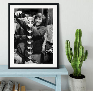George Best pouring champagne Framed Print - Canvas Art Rocks - 1