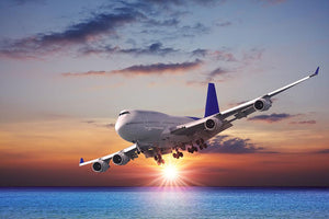 Jet liner over the sea at dusk Wall Mural Wallpaper - Canvas Art Rocks - 1